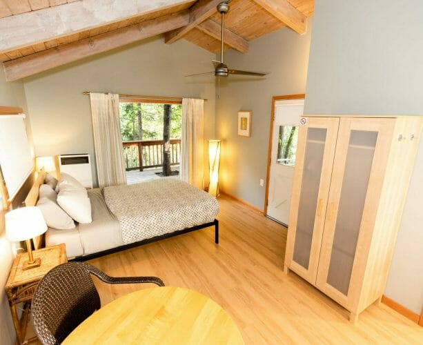 an interior view of the main bedroom of reverie retreat cottage