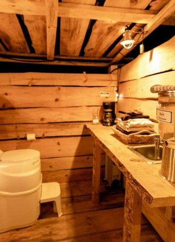 the view inside the bathroom and the kitchen area of blackberry yurt