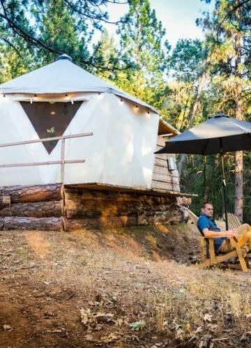 a man sitting outside the ponderosa yurt