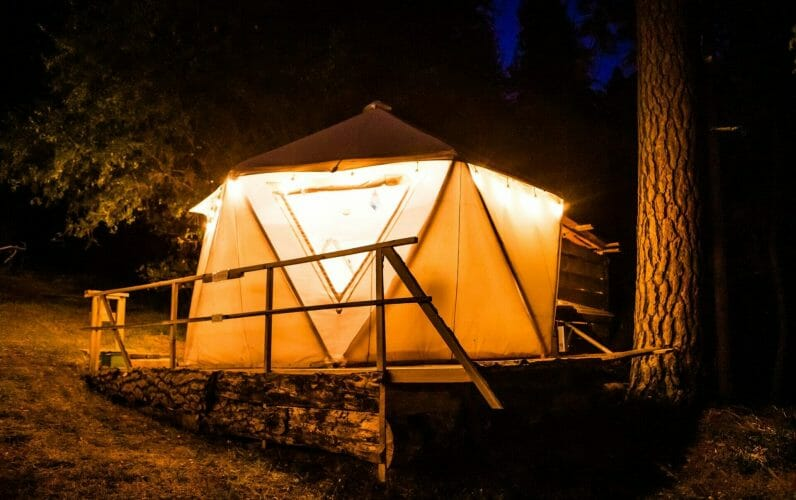 a view from the exterior of blackberry yurt during the night