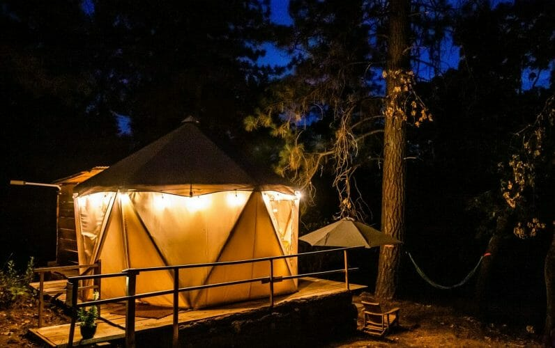 The exteriors of the yurts at evening