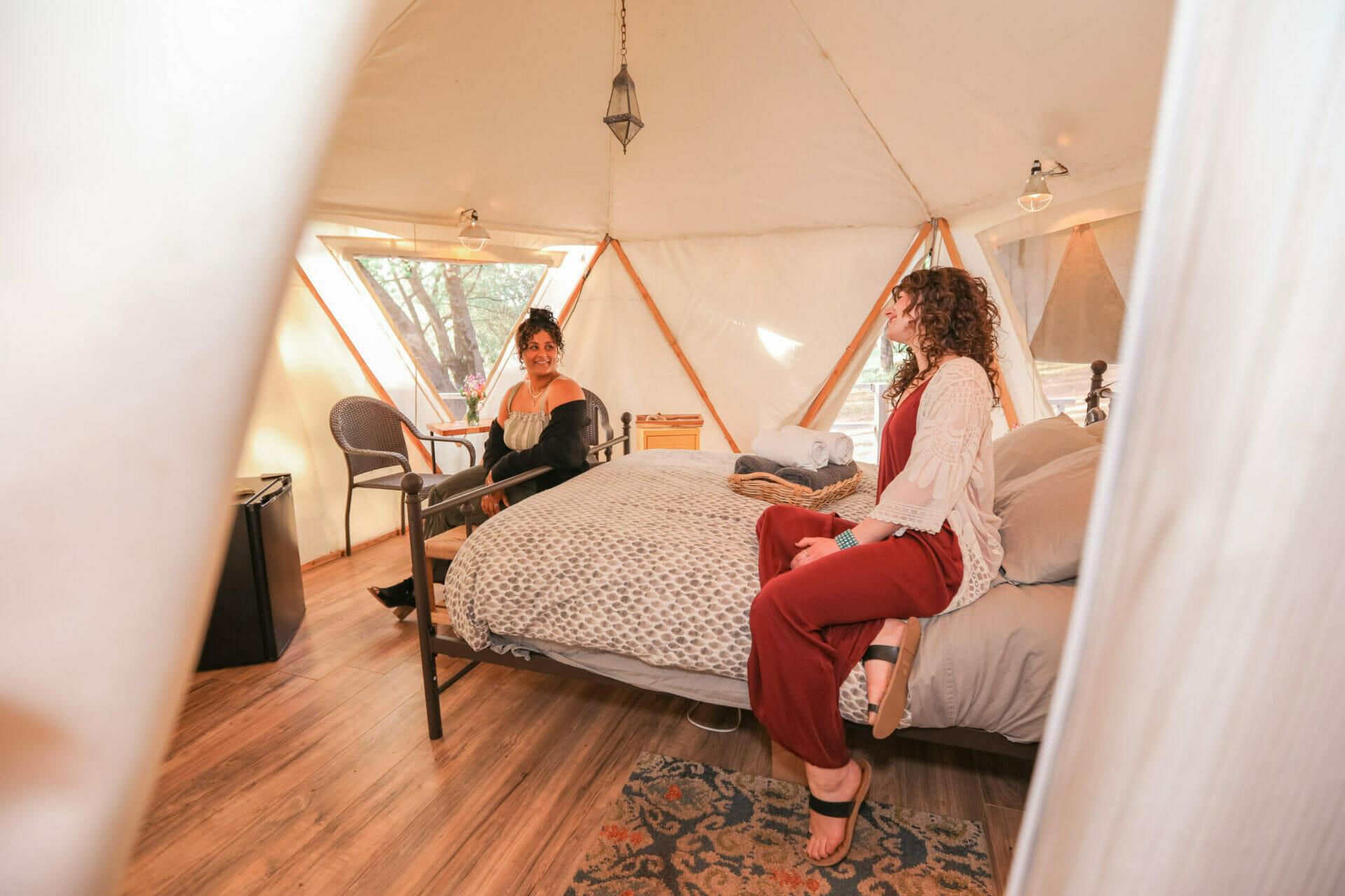 Reverie retreat inside yurt two woman speaking