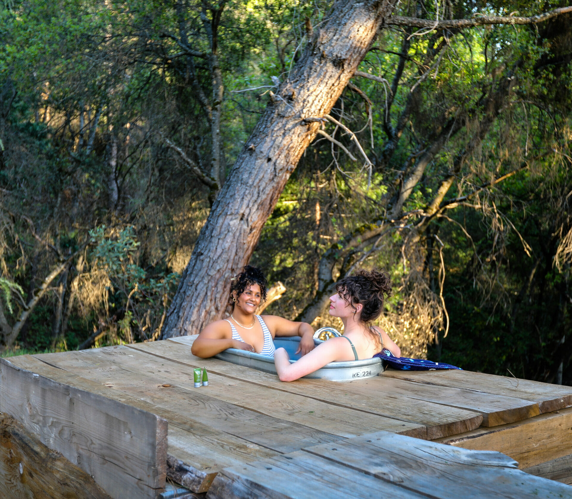 Reverie Retreat two women in the outdoors hot tub